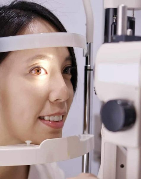 asian-woman-do-eye-test-at-clinic-KFVZZFP-min-scaled